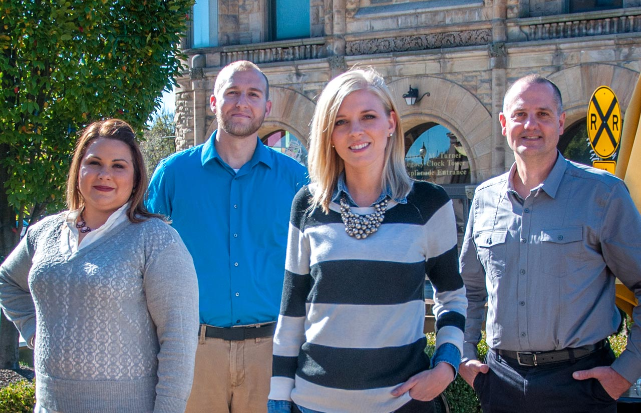 Holmes Marketing Team Members from left to right, Heather Leifheit, Mike England, Karleigh Spahr, and Kevin Holmes