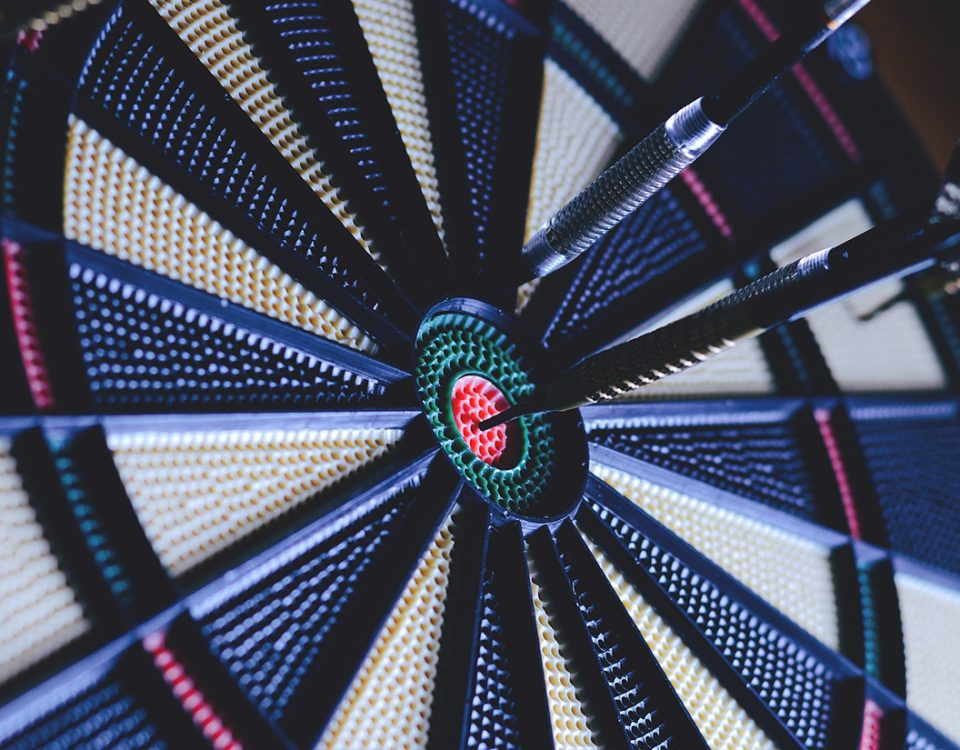 dartboard with darts in and near bullseye