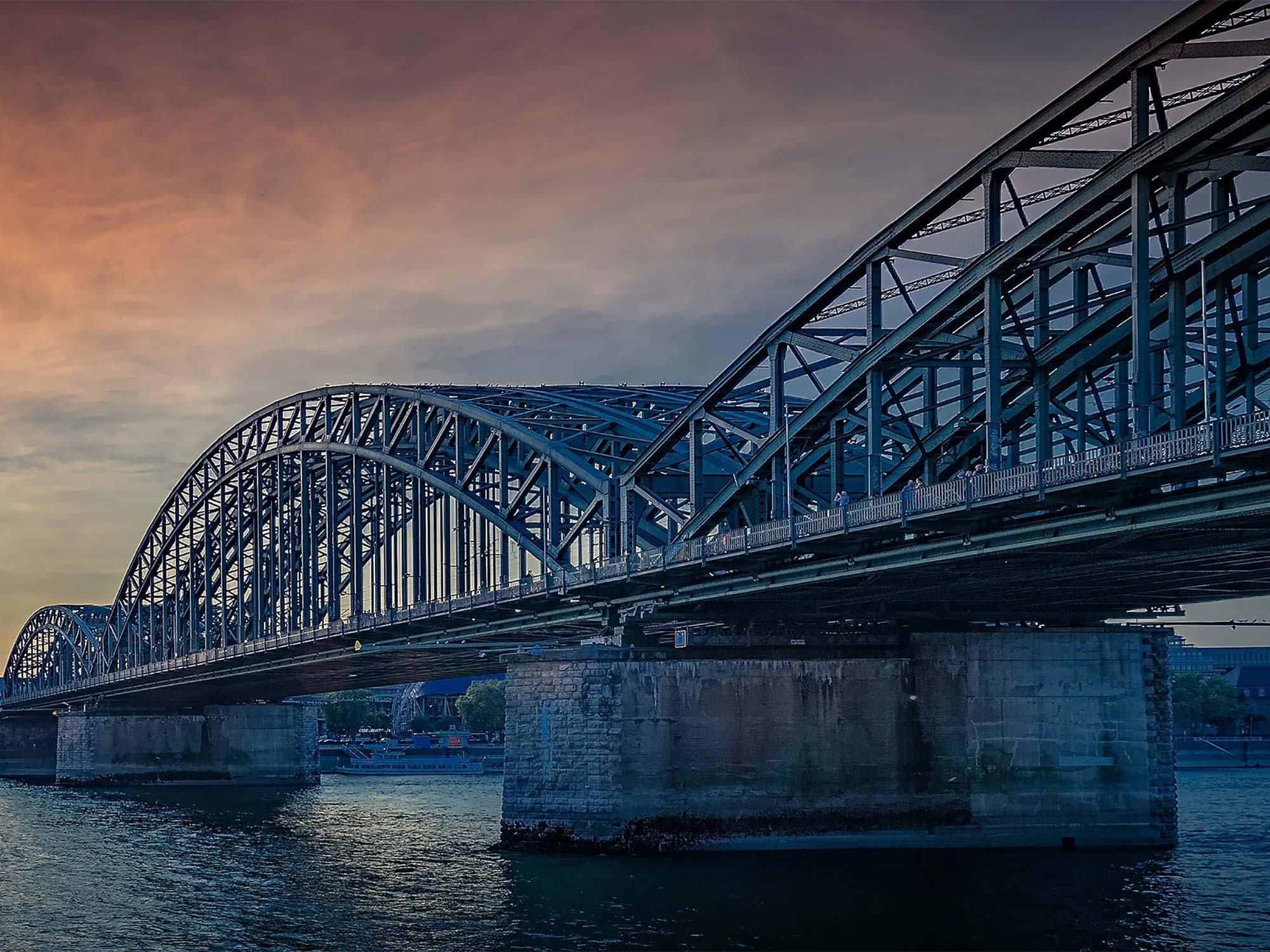 bridge over water at sunset