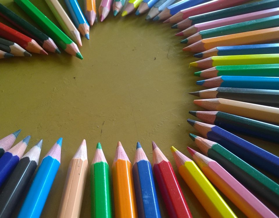 Colored pencils in the shape of a heart