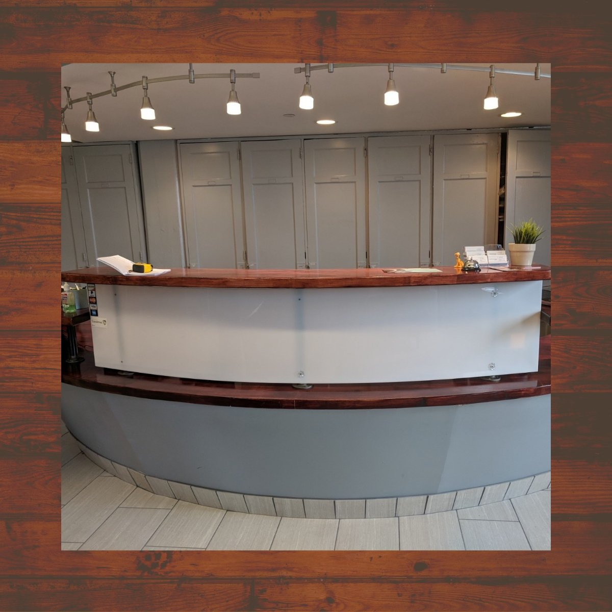 Front desk before creative install at LWS